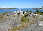 Child Enjoying View of Archipelago on Island of Kökar, Åland, Finland