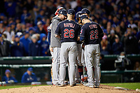 Cleveland Indians pitching coach Mickey Callaway talks with pitcher Trevor Bauer (right) in the fourth inning during Game 5 of the Major League Baseball World Series against the Chicago Cubs on October 30, 2016 at Wrigley Field in Chicago, Illinois.  Mike Napoli (26) and Jason Kipnis (22) also shown.  (Mike Janes/Four Seam Images)