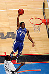 Kentucky guard Rajon Rondo (4) dunks over Connecticut forward Denham Brown (33).  Connecticut defeated Kentucky 87-83 in the second round of the NCAA Tournament  at the Wachovia Center in Philadelphia, Pennsylvania on March 19, 2006.