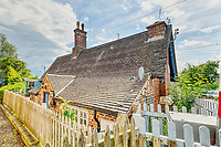 BNPS.co.uk (01202 558833)<br /> Pic: PropertyPublicity/BNPS<br /> <br /> Pictured: The cottage was built in 1850<br /> <br /> Loco-cation, loco-cation, loco-cation..<br /> <br /> This quirky property that is up for sale is all about its loco-cation - as it sits on a railway crossing right next to the train tracks.<br /> <br /> The Grade II listed cottage was built in 1850 to house the gatekeeper whose job it was to close the gates at the road crossing whenever a train was due.<br /> <br /> The gates, in the village of Stone, Staffs, were automated many years ago.