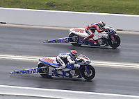 Apr. 28, 2013; Baytown, TX, USA: NHRA pro stock motorcycle rider Hector Arana Jr (near lane) races alongside his father Hector Arana Sr during the Spring Nationals at Royal Purple Raceway. Mandatory Credit: Mark J. Rebilas-