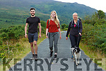 Laura Griffin centre along with Luke Stuart Mills and Denise Buckley and Daisy who climbed five mountains in five days in memory of her dad Tom at Mangerton Mountain on Monday