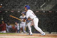Buffalo Bisons left fielder Darrell Ceciliani (10) at bat in the pouring rain during a game against the Lehigh Valley IronPigs on July 9, 2016 at Coca-Cola Field in Buffalo, New York.  Lehigh Valley defeated Buffalo 9-1 in a rain shortened game.  (Mike Janes/Four Seam Images)