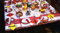 Table set with red and white napkins and table cloth. Many small plates with different kind of dishes. Tradita traditional restaurant, Shkodra. Albania, Balkan, Europe.