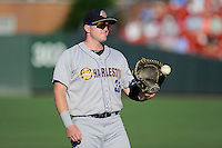 First baseman Connor Spencer (33) of the Charleston RiverDogs warms up before a game against the Greenville Drive on Saturday, May 23, 2015, at Fluor Field at the West End in Greenville, South Carolina. Charleston won 5-4. (Tom Priddy/Four Seam Images)