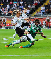Alexandra Popp (l) of team Germany and Osinachi Ohale of team Nigeria during the FIFA Women's World Cup at the FIFA Stadium in Frankfurt, Germany on June 30th, 2011.