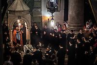 Armenian Orthodox Priests celebrating at the Stone of three women (Armenian Shrine). Jerusalem