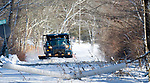 WOODBURY, CT-122517JS07--A Woodbury town truck plows snow off Trolley Bed Road and Old Sherman Hill Road in Woodbury on Monday after a fast moving snow storm moved through the state. <br /> Jim Shannon Republican-American