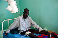 Africa, Sudan, Magwi County, Nimule, Caught In Between, Northern Uganda/Southern Sudan - The man pictured here resting at Merlin Hospital was shot by the Lord's Resistance Army in 2005. The war in the region began in 1986 between the Lord's Resistance Army and the Ugandan People's Defense Forces (UPDF). The LRA has reigned terror and carnage on Northern Uganda and Southern Sudan ever since. The ongoing conflict has significantly damaged the region and has left an ongoing burden on the local population. December 2005 © Stephen Blake Farrington