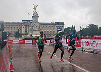 4th October 2020, London, England; 2020 London Marathon; Shura Kitata (ETH) (centre) Vincent Kipchumba (KEN) (right) and Sisay Lemma (ETH) (left) sprinting for the finish line at the end of the Elite Men's Race at the historic elite-only Virgin Money London Marathon taking place on a closed-loop circuit around St James's Park in central London on Sunday 4 October 2020.