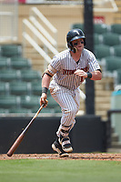 Evan Skoug (11) of the Kannapolis Intimidators starts down the first base line Hagerstown Suns at Kannapolis Intimidators Stadium on July 17, 2018 in Kannapolis, North Carolina. The Intimidators defeated the Suns 10-9. (Brian Westerholt/Four Seam Images)