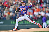 Clemson Tigers starting pitcher Zach Erwin (33) warms up before a game against the South Carolina Gamecocks at Fluor Field February 28, 2015 in Greenville, South Carolina. The Gamecocks defeated the Tigers 4-1. (Tony Farlow/Four Seam Images)