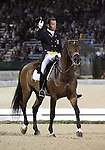 Michal Rapcewicz and Randon of Poland perform their Freestyle Dressage in the Grand Prix Freestyle Dressage competition at the Alltech World Equestrian Games in Lexington, Kentucky.