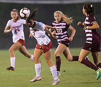 Hawgs Illustrated/BEN GOFF <br /> Madison Louk of Arkansas heads the ball in the first half vs Texas A&M Thursday, Sept. 20, 2018, at Razorback Field in Fayetteville.