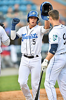 Asheville Tourists Korey Lee (5) is congratulated after hitting a home run during a game against the Greenville Drive on May 19, 2021 at McCormick Field in Asheville, NC. (Tony Farlow/Four Seam Images)