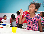 Waterbury, CT- 07 August 2015-080715CM03- Anu Lounsbury  8, of Waterbury, blows bubbles during the 2015 Greater Waterbury Campership Program at Girls Inc. in Waterbury on Friday.  The theme of the week was animals and the children made crafts which resembled various sea life.     Christopher Massa Republican-American