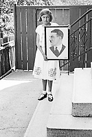 Girl holding a portrait of Hitler, Germany 1932-35<br /> photographed by Wilhem Walther