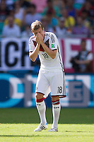 Toni Kroos of Germany holds his nose after a knock