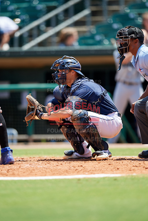 Montgomery Biscuits catcher Brett Sullivan (7) waits to receive a pitch in front of home plate umpire Edwin Moscoso during a game against the Biloxi Shuckers on May 8, 2018 at Montgomery Riverwalk Stadium in Montgomery, Alabama.  Montgomery defeated Biloxi 10-5.  (Mike Janes/Four Seam Images)
