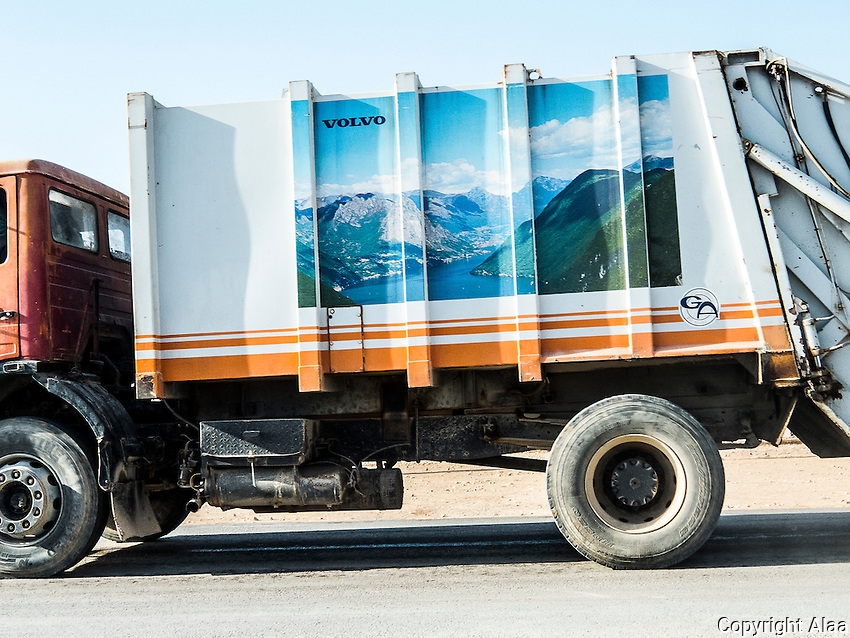 This truck transfers garbage to save us from its impact on the environment. I liked the picture on the truck. Mountains and water on the side of a desert gargbage truck.