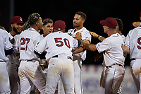 Mahoning Valley Scrappers Michael Cooper (center) is mobbed by teammates, including Pedro Alfonseca (27), Jonathan Lopez (50), and Bryan Lavastida (1), after hitting a walk off single during a NY-Penn League game against the Hudson Valley Renegades on July 15, 2019 at Eastwood Field in Niles, Ohio.  Mahoning Valley defeated Hudson Valley 6-5.  (Mike Janes/Four Seam Images)