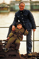 Portrait of a Chinese boy and his grandfather. People. Family. Kin. Kinship. Children. Grandparents. Boy and Grandfather. Wohan, China.