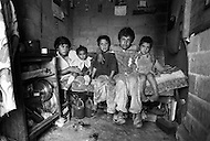 Street urchins in Bogota, Colombia  - Child labor as seen around the world between 1979 and 1980 – Photographer Jean Pierre Laffont, touched by the suffering of child workers, chronicled their plight in 12 countries over the course of one year.  Laffont was awarded The World Press Award and Madeline Ross Award among many others for his work.