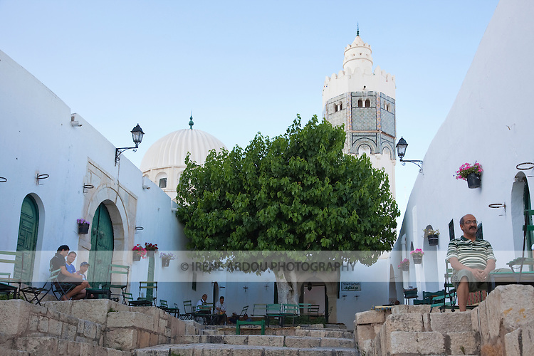 Downhill from Sidi Bou Makhlouf mosque in El Kef, residents relax at in an open square flanked by cafes.