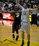 13 December 2008: Albany's Brett Gifford attempts to block a shot by Canisius' Frank Turner during a game between Canisius and Albany won by Albany 74-46 at SEFCU Arena in Albany, New York.