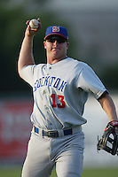 Drew Meyer of the Stockton Ports throws before a game against the Inland Empire 66ers at Staters Bros Stadium on June 5, 2003 in San Bernardino, California. (Larry Goren/Four Seam Images)