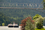 Barge on the Columbia River with the Bridge of the Gods at Cascade Locks, Oregon