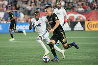 FOXBOROUGH, MA - AUGUST 4: Eduard Atuesta #20 of Los Angeles FC advances the ball with Luis Caicedo #27 of New England Revolution in pursuit during a game between Los Angeles FC and New England Revolution at Gillette Stadium on August 3, 2019 in Foxborough, Massachusetts.