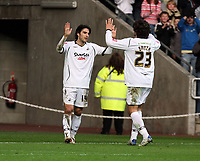 ATTENTION SPORTS PICTURE DESK<br /> Pictured: Jordi Gomez of Swansea (L) celebrating his goal with team mate and fellow double scorer Jason Scotland (R).<br /> Re: Coca Cola Championship, Swansea City FC v Doncaster Rovers at the Liberty Stadium. Swansea, south Wales, Saturday 21 February 2009<br /> Picture by D Legakis Photography / Athena Picture Agency, Swansea 07815441513