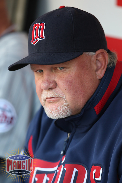 OAKLAND, CA - AUGUST 30:  Manager Ron Gardenhire of the Minnesota Twins gets ready in the dugout before the game against the Oakland Athletics at the McAfee Coliseum in Oakland, California on August 30, 2008.  The Athletics defeated the Twins 3-2.  Photo by Brad Mangin