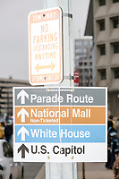 A sign shows directions to the parade route, National Mall, White House, and US Capitol, as people gather in the National Mall area of Washington, DC, for the Women's March on Washington protest and demonstration in opposition to newly inaugurated President Donald Trump on Jan. 21, 2017.