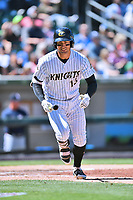 Charlotte Knights third baseman Nicky Delmonico (13) runs to first base after being walked during a game against the  Gwinnett Braves at BB&T Ballpark on May 7, 2017 in Charlotte, North Carolina. The Knights defeated the Braves 7-1. (Tony Farlow/Four Seam Images)