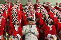 105 Santa costumed singers celebrate 105th anniversary of Tokyo station
