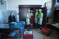 3 Days of De Panne.stage 1: Middelkerke - Zottegem..Riders sign inn on stage inside the Middelkerke casino and get backstage via the kitchen