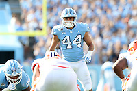 CHAPEL HILL, NC - SEPTEMBER 28: Jeremiah Gemmel #44 of the University of North Carolina looks over the line of scrimmage during a game between Clemson University and University of North Carolina at Kenan Memorial Stadium on September 28, 2019 in Chapel Hill, North Carolina.
