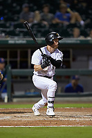 Charlie Tilson (1) of the Charlotte Knights follows through on his swing against the Durham Bulls at BB&T BallPark on July 31, 2019 in Charlotte, North Carolina. The Knights defeated the Bulls 9-6. (Brian Westerholt/Four Seam Images)