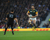 Damian de Allende of South Africa looks to outfox Dan Carter of New Zealand during the Semi Final of the Rugby World Cup 2015 between South Africa and New Zealand - 24/10/2015 - Twickenham Stadium, London<br /> Mandatory Credit: Rob Munro/Stewart Communications