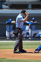 Home plate umpire Kyle Stutz makes a strike call during the Appalachian League game between the Greeneville Reds and the Burlington Royals at Burlington Athletic Stadium on July 8, 2018 in Burlington, North Carolina. The Royals defeated the Reds 4-2.  (Brian Westerholt/Four Seam Images)