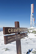 Crawford Path sign on the summit of Mount Washington in the White Mountains, New Hampshire during the winter months. Mount Washington, at 6,288 feet, is the tallest mountain in the northeastern United States.