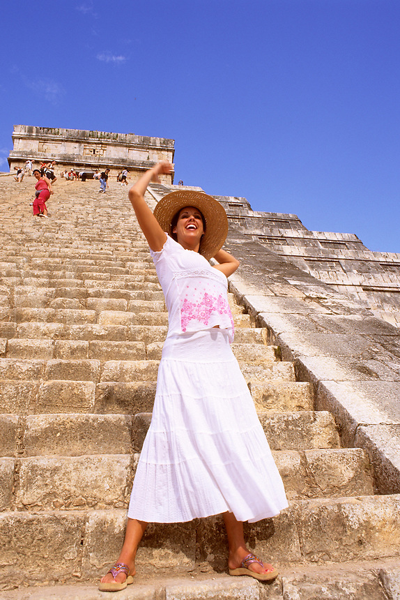Beautiful hispanic woman at the famous Myan Ruins of Chichen Itza in Mexic