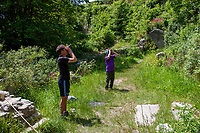 BNPS.co.uk (01202 558833)<br /> Pic: UKButterflies/BNPS<br /> <br /> Pictured: Will Langdon and Matthew Oates looking up at elm trees at Church Ope in Portland, Dorset, for evidence of Large Tortoiseshell larvae. <br /> <br /> A giant butterfly which was presumed extinct for over 50 years is breeding again in Britain.<br /> <br /> The Large Tortoiseshell, Latin-name Nymphalis polychloros, disappeared from British woodlands in the 1960s due to the effects of Dutch Elm disease, climate change and parasitic flies.<br /> <br /> But conservationists have now discovered two groups of orange-spined larvae nestling on the upper surface of elms on the isle of Portland, Dorset.