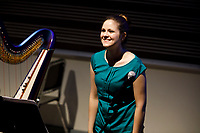 Harpist Sydney Campen stands for recognition after performing a piece during the Composition Forum at the 11th USA International Harp Competition at Indiana University in Bloomington, Indiana on Monday, July 8, 2019. (Photo by James Brosher)