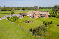 BNPS.co.uk (01202 558833)<br /> Pic: Savills/BNPS<br /> <br /> Pictured: An aerial view of the rear of the property.<br /> <br /> A historic thatched home where Cromwell's army stayed during the English Civil War is on the market for £1.6m.<br /> <br /> The Barracks, so-named for its links with Cromwell more than 370 years ago, has spectacular country views and is in one of Cheshire's most popular areas.<br /> <br /> The five-bedroom property just outside the picturesque village of Bunbury is a far cry from how it would have looked in Cromwell's time, having been extended over the years.<br /> <br /> It was used in the 17th century by Cromwell's armies during the siege of Beeston Castle - two miles away. The castle's location made it valuable to both the royalists and parliamentarians.