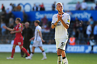Mike van der Hoorn of Swansea City applauds the fans at the final whistle during the Sky Bet Championship match between Swansea City and Nottingham Forest at the Liberty Stadium in Swansea, Wales, UK. Saturday 14 September 2019