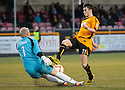 Stenny keeper Callum Reidford saves at the feet of Alloa's Kevin Cawley.