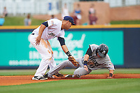 Pensacola Blue Wahoos second baseman Ryan Wright (6) attempts to tag Kyle Wren (11) stealing second during the second game of a double header against the Biloxi Shuckers on April 26, 2015 at Pensacola Bayfront Stadium in Pensacola, Florida.  Pensacola defeated Biloxi 2-1.  (Mike Janes/Four Seam Images)
